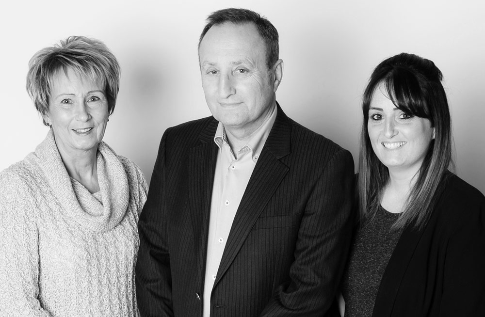 A photo of the Libra Office Interiors team: Paul, Barbara and Lauren Billig